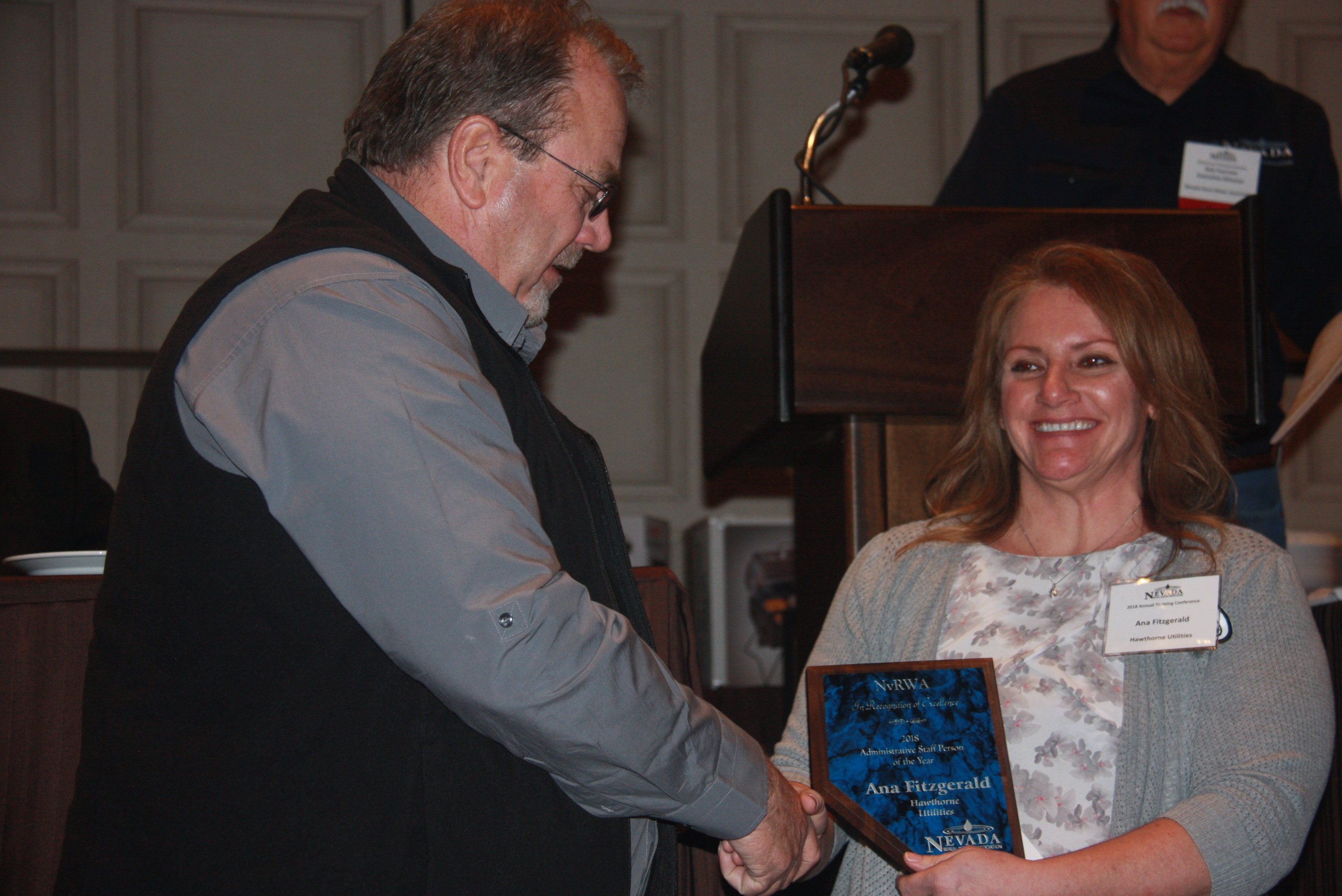 Ana-Fitzgerald-with-Hawthorne-Utilities-receiving-her-Administrative-Person-of-the-Year-Award-from-NvRWA-Board-President-Cameron-McKay-2